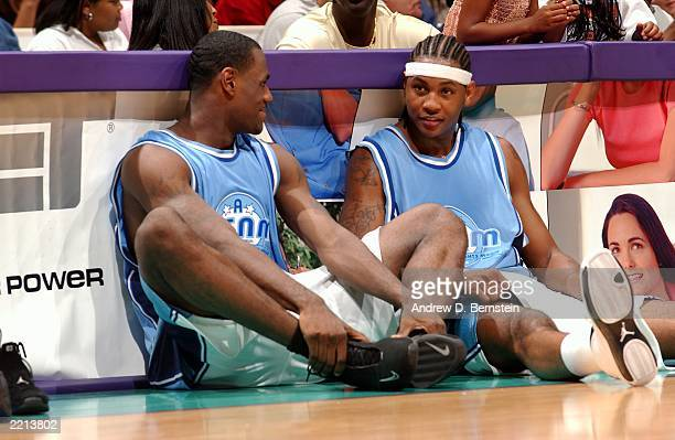 LeBron James and Carmelo Anthony chat while waiting to check into the game during Magic Johnson's18th annual 'A Midsummer Night's Magic' charity game...