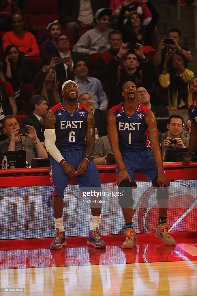 LeBron James #6 and Chris Bosh #1 of the Eastern Conference All-Stars smile and wait to get into the game against the Western Conference All-Stars during 2013 NBA All-Star Game on February 17, 2013 at Toyota Center in Houston, Texas.