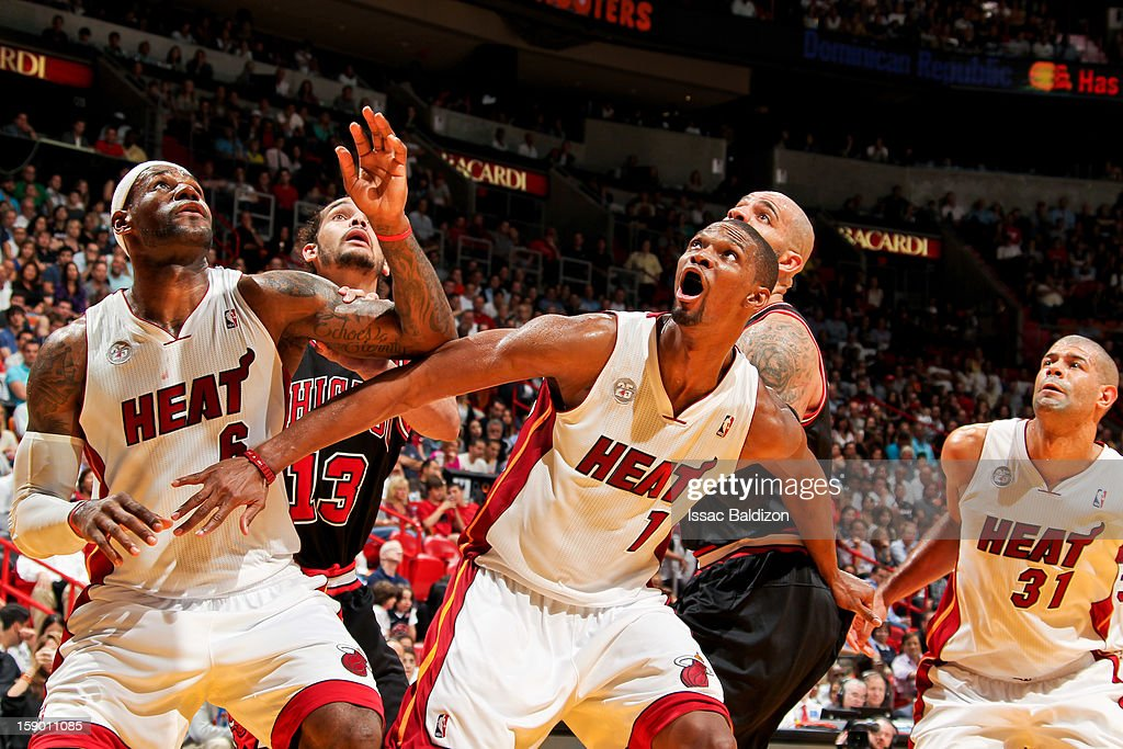 LeBron James #6 and Chris Bosh #1 of the Miami Heat battle for rebound position against Joakim Noah #13 and Carlos Boozer #5 of the Chicago Bulls on January 4, 2013 at American Airlines Arena in Miami, Florida.