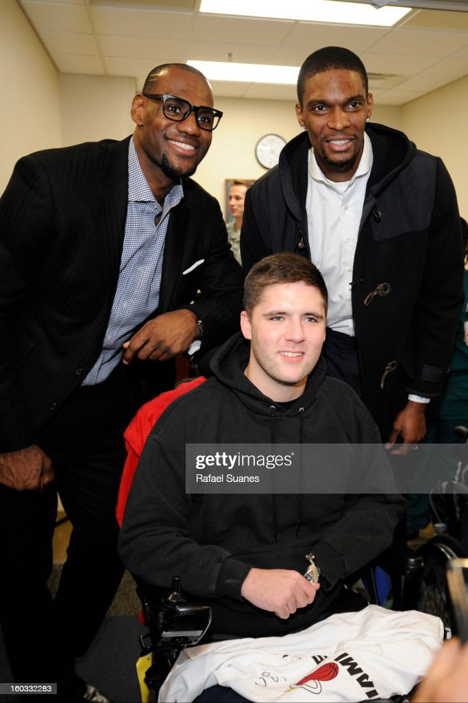 LeBron James and Chris Bosh of the Miami Heat pose for a picture with serviceman Samuel Wally during a visit to Walter Reed National Military Medical Center on January 28, 2012 Bethesda, MD.