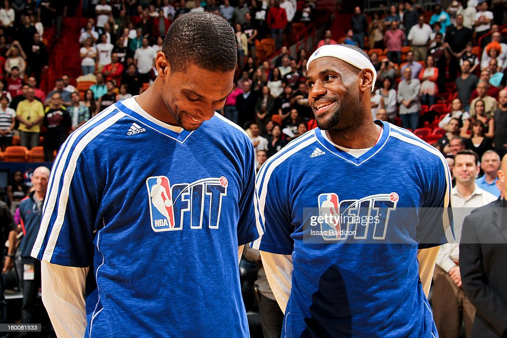 LeBron James #6 and Chris Bosh #1 of the Miami Heat share a laugh before the National Anthem prior to playing the Detroit Pistons on January 25, 2013 at American Airlines Arena in Miami, Florida.
