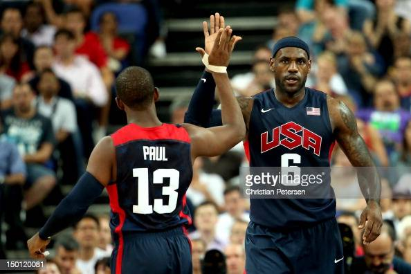 LeBron James and Chris Paul of United States celebrate a made basket by James in the second quarter while taking on Argentina during the Men's...