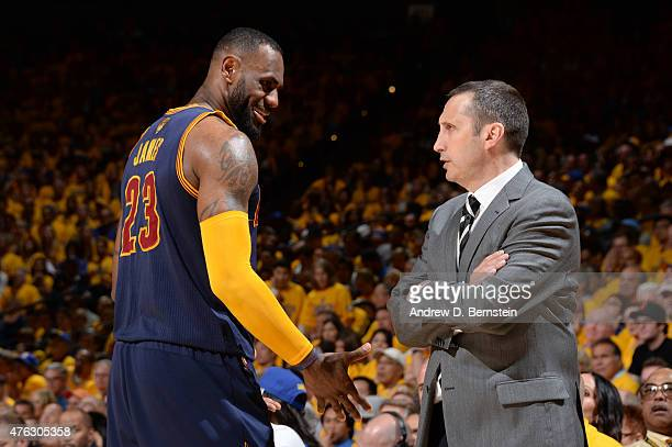 LeBron James and David Blatt of the Cleveland Cavaliers converse during Game Two of the 2015 NBA Finals on June 7 2015 at Oracle Arena in Oakland...
