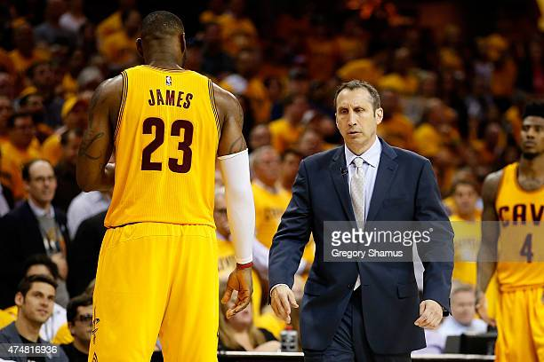 LeBron James and David Blatt of the Cleveland Cavaliers look on late in the game against the Atlanta Hawks during Game Four of the Eastern Conference...