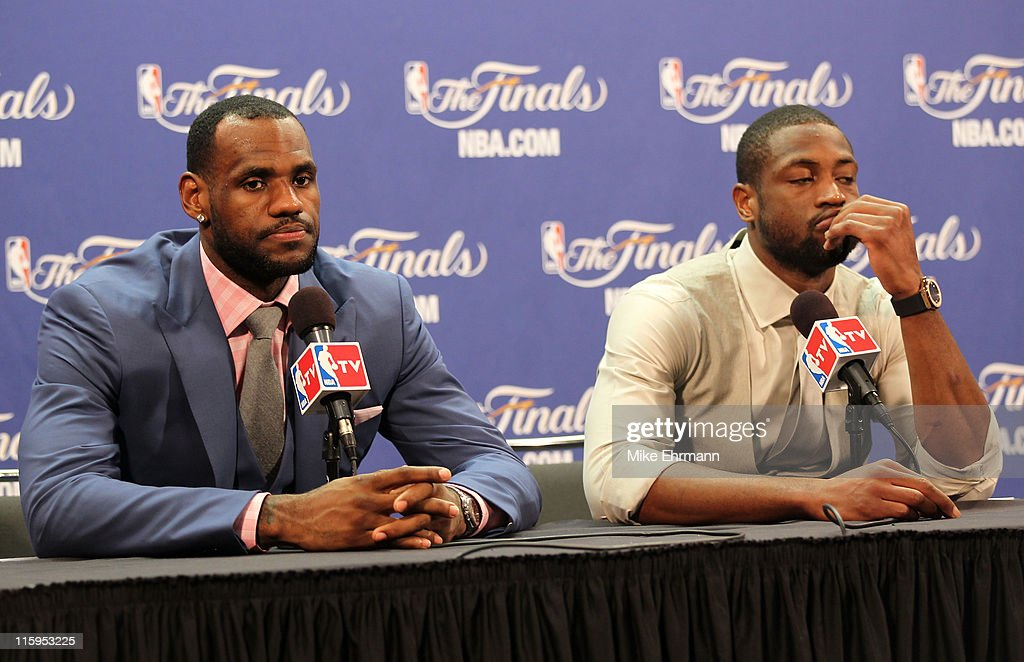 LeBron James #6 and Dwyane Wade #3 of the Miami Heat answer questions after the Heat were defeated 105-95 by the Dallas Mavericks in Game Six of the 2011 NBA Finals at American Airlines Arena on June 12, 2011 in Miami, Florida.
