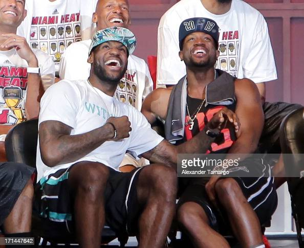 LeBron James and Dwyane Wade of the Miami Heat attend the NBA Championship victory rally at the AmericanAirlines Arena on June 24 2013 in Miami...