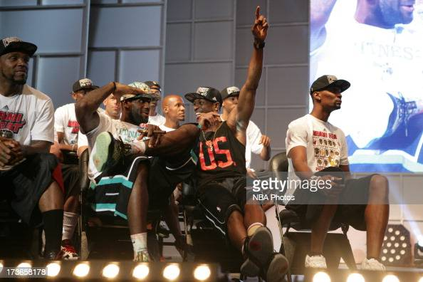 LeBron James and Dwyane Wade of the Miami Heat celebrates during the rally for seasonticket holders at the American Airlines Arena after their NBA...