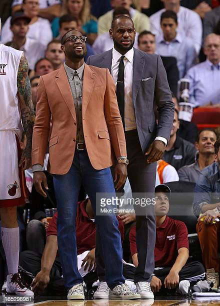 LeBron James and Dwyane Wade of the Miami Heat cheer from the bench during a game against the New York Knicks at American Airlines Arena on April 2...