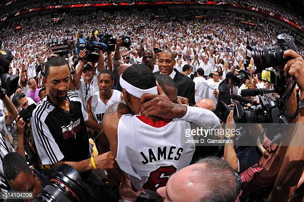 LeBron James and Dwyane Wade of the Miami Heat get emotional after closing out the series against the Boston Celtics in Game Five of the Eastern...