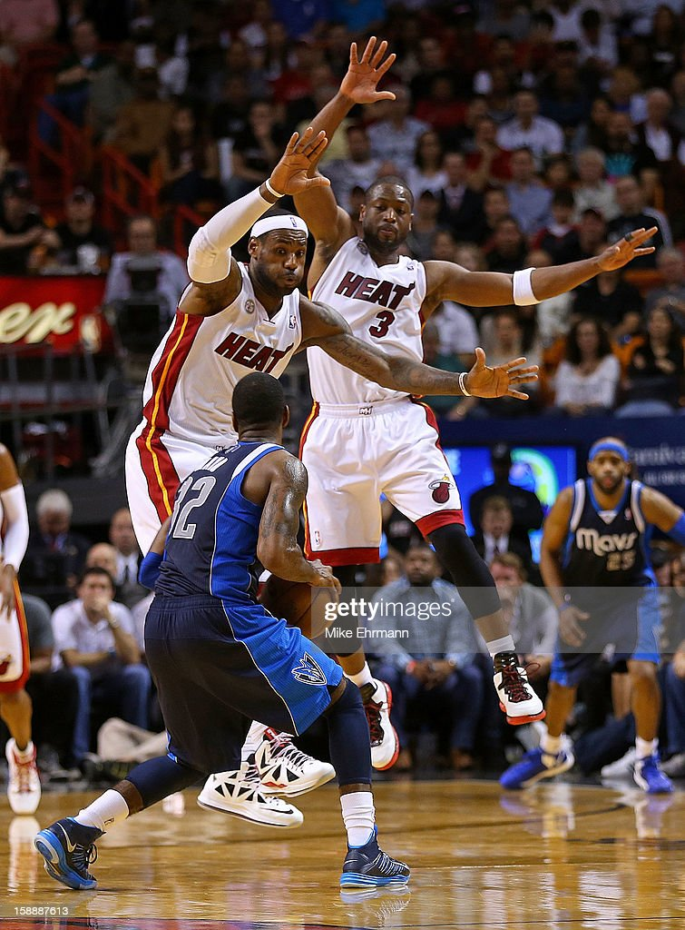 LeBron James #6 and Dwyane Wade #3 of the Miami Heat guard O.J. Mayo #32 of the Dallas Mavericks during a game at American Airlines Arena on January 2, 2013 in Miami, Florida.