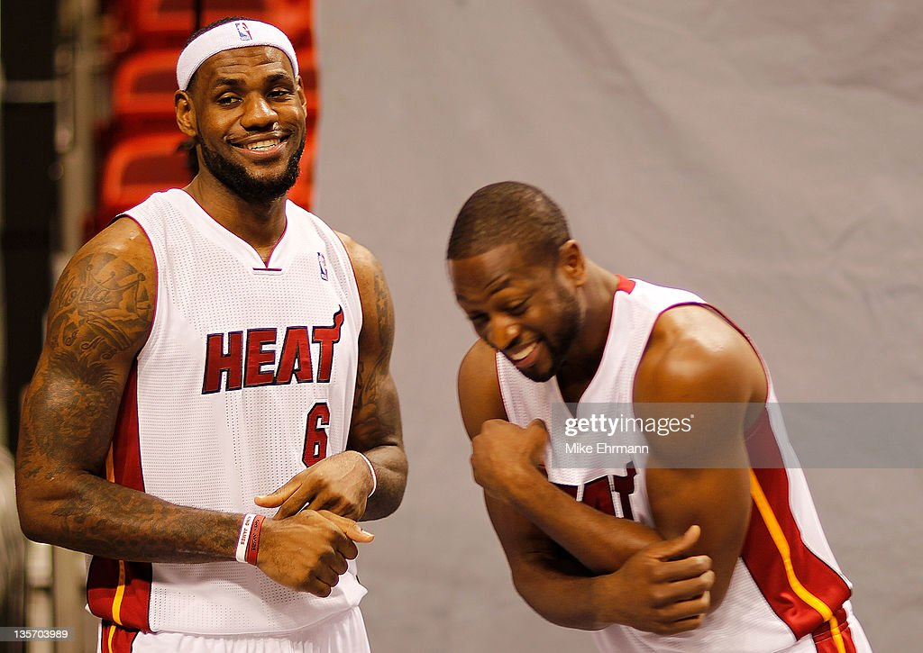 LeBron James #6 and Dwyane Wade #3 of the Miami Heat laugh during media day at American Airlines Arena on December 12, 2011 in Miami, Florida.