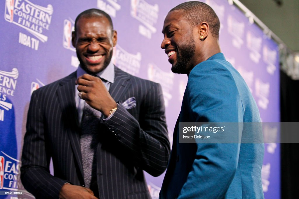 LeBron James #6 and Dwyane Wade #3 of the Miami Heat smile at a press conference following their team's victory against the Indiana Pacers in Game One of the Eastern Conference Finals during the 2013 NBA Playoffs on May 22, 2013 at American Airlines Arena in Miami, Florida.