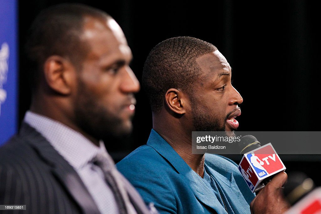 LeBron James #6 and Dwyane Wade #3 of the Miami Heat speak at a press conference following their team's victory against the Indiana Pacers in Game One of the Eastern Conference Finals during the 2013 NBA Playoffs on May 22, 2013 at American Airlines Arena in Miami, Florida.