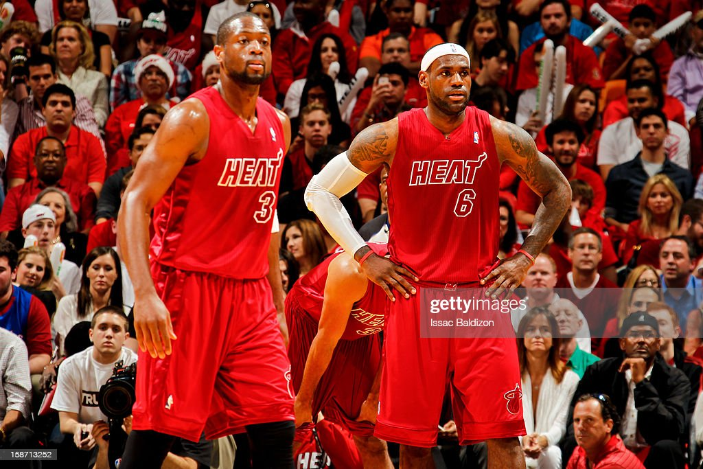 LeBron James #6 and Dwyane Wade #3 of the Miami Heat wait to resume action against the Oklahoma City Thunder during a Christmas Day game on December 25, 2012 at American Airlines Arena in Miami, Florida.