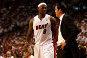 LeBron James and head coach Erik Spoelstra of the Miami Heat talk against the Chicago Bulls in Game Four of the Eastern Conference Finals during the...