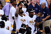 LeBron James and JR Smith of the Cleveland Cavaliers celebrate after defeating the Atlanta Hawks during Game Four of the Eastern Conference Finals of...