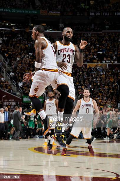 LeBron James and JR Smith of the Cleveland Cavaliers celebrate during Game Three of the Eastern Conference Finals of the 2017 NBA Playoffs on May 21...