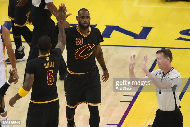 LeBron James and JR Smith of the Cleveland Cavaliers react to a play in Game 5 of the 2017 NBA Finals against the Golden State Warriors at ORACLE...