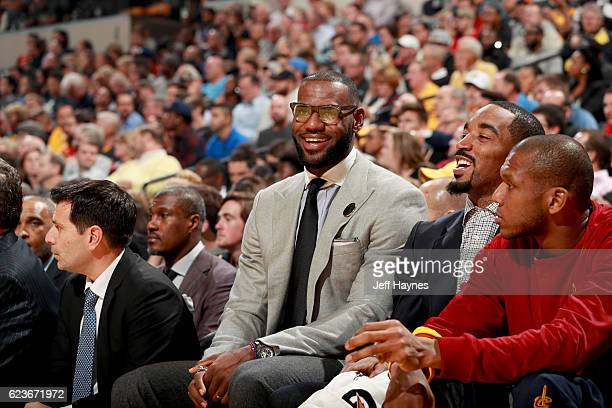 LeBron James and JR Smith of the Cleveland Cavaliers smile from the sidelines on November 16 2016 at Bankers Life Fieldhouse in Indianapolis Indiana...