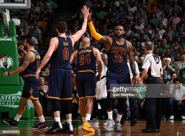 LeBron James and Kevin Love of the Cleveland Cavaliers high five each other during the game against the Boston Celtics during Game One of the Eastern...