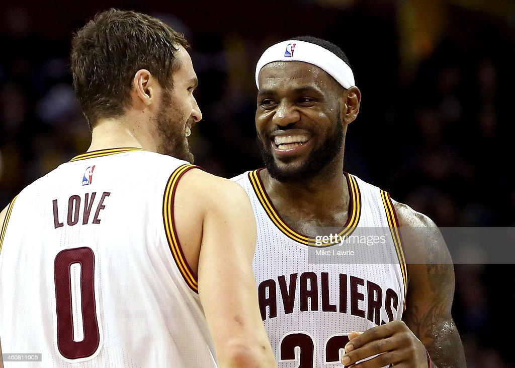 LeBron James #23 and Kevin Love #0 of the Cleveland Cavaliers react after a play in the second half against the Minnesota Timberwolves at Quicken Loans Arena on December 23, 2014 in Cleveland, Ohio.