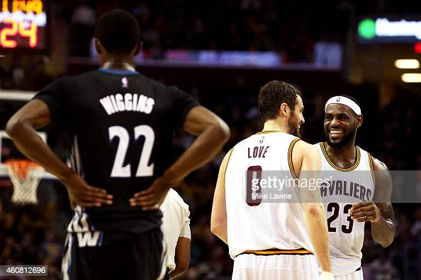 LeBron James and Kevin Love of the Cleveland Cavaliers react after a play in the second half as Andrew Wiggins of the Minnesota Timberwolves looks on...
