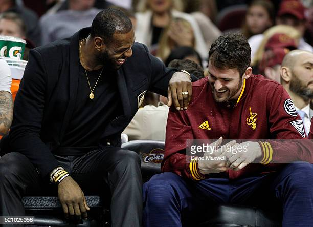 LeBron James and Kevin Love of the Cleveland Cavaliers share a laugh on the bench against the Detroit Pistons during the second half of their game at...