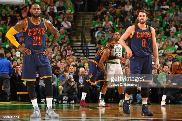 LeBron James and Kevin Love of the Cleveland Cavaliers stand on the court before Game Five of the Eastern Conference Finals against the Boston...