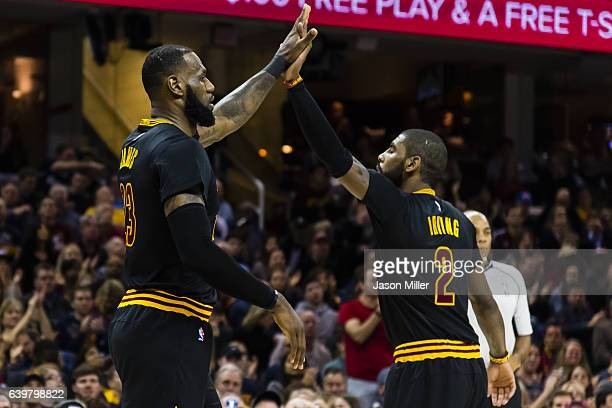 LeBron James and Kyrie Irving of the Cleveland Cavaliers celebrate after a play during the first half against the San Antonio Spurs at Quicken Loans...