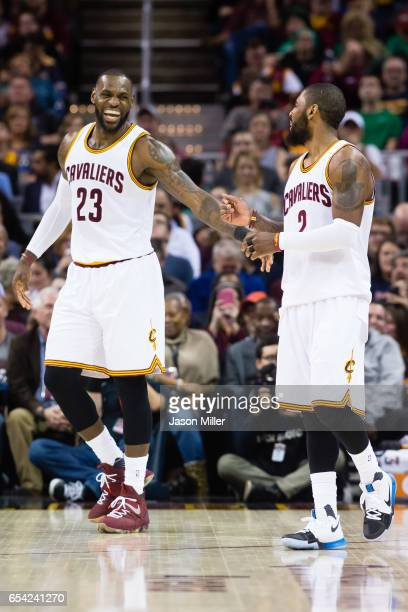 LeBron James and Kyrie Irving of the Cleveland Cavaliers celebrate after a play during the second half against the Utah Jazz at Quicken Loans Arena...