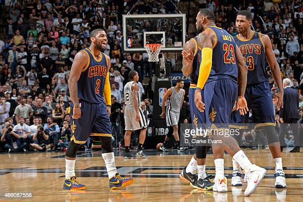 LeBron James and Kyrie Irving of the Cleveland Cavaliers celebrate during the game against the San Antonio Spurs at the ATT Center on March 12 2015...