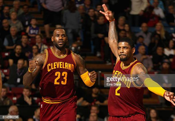 LeBron James and Kyrie Irving of the Cleveland Cavaliers celebrate during the fourth quarter of their game against the Sacramento Kings at Sleep...