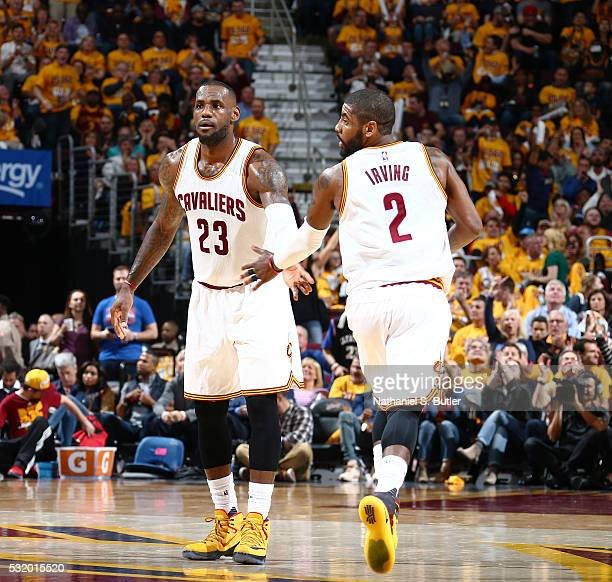 LeBron James and Kyrie Irving of the Cleveland Cavaliers celebrate against the Toronto Raptors in Game One of the Eastern Conference Finals during...