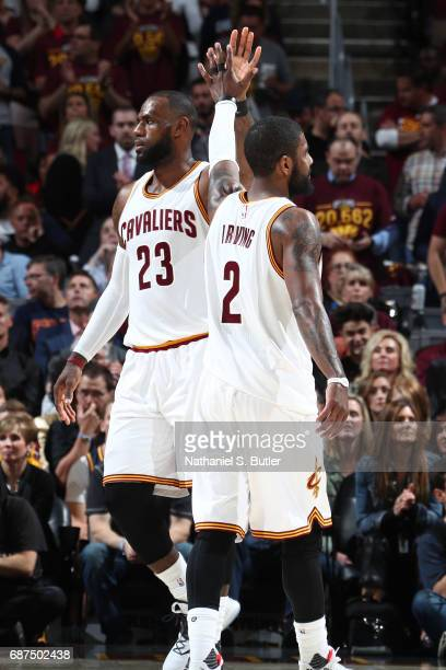 LeBron James and Kyrie Irving of the Cleveland Cavaliers high five during the game against the Boston Celtics in Game Four of the Eastern Conference...