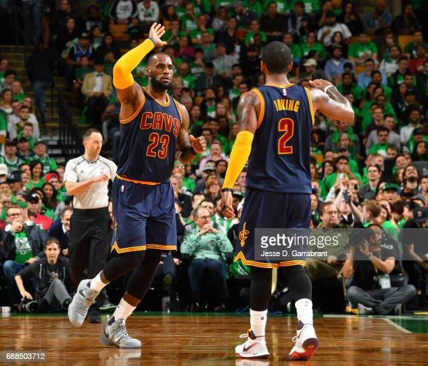 LeBron James and Kyrie Irving of the Cleveland Cavaliers high five each other during the game against the Boston Celtics during Game Five of the...