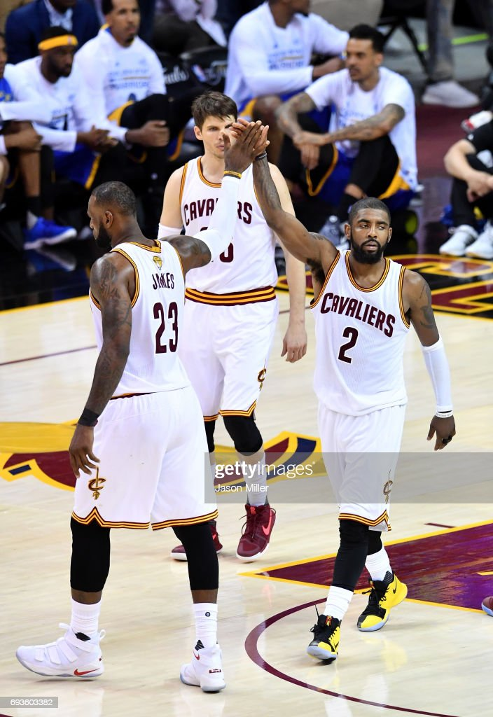 LeBron James #23 and Kyrie Irving #2 of the Cleveland Cavaliers react after a play in the second half in Game 3 of the 2017 NBA Finals at Quicken Loans Arena on June 7, 2017 in Cleveland, Ohio.