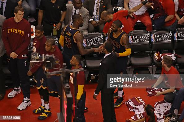 LeBron James and Kyrie Irving of the Cleveland Cavaliers shake hands in Game Six of the NBA Eastern Conference Finals against the Toronto Raptors at...