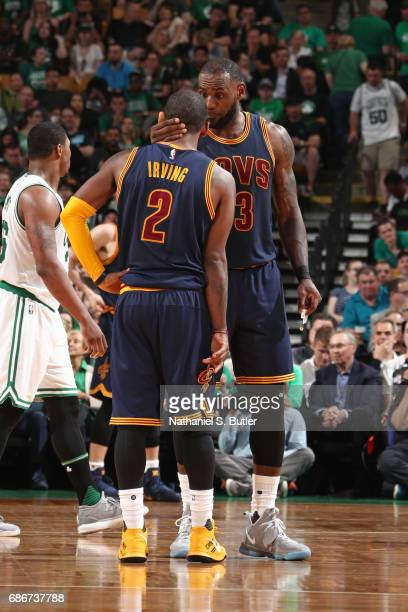 LeBron James and Kyrie Irving of the Cleveland Cavaliers talk in Game One of the Eastern Conference Finals against the Boston Celtics during the 2017...