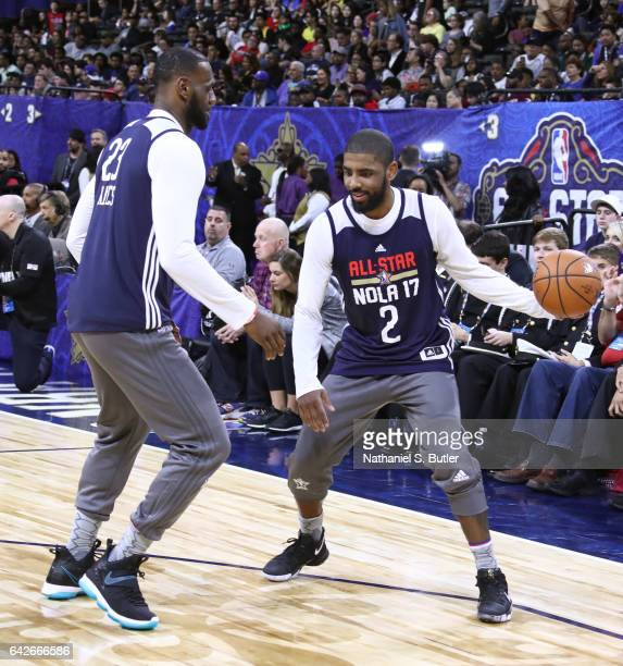 LeBron James and Kyrie Irving of the Eastern Conference All Star Team guard each other during NBA AllStar Practice as part of 2017 AllStar Weekend at...