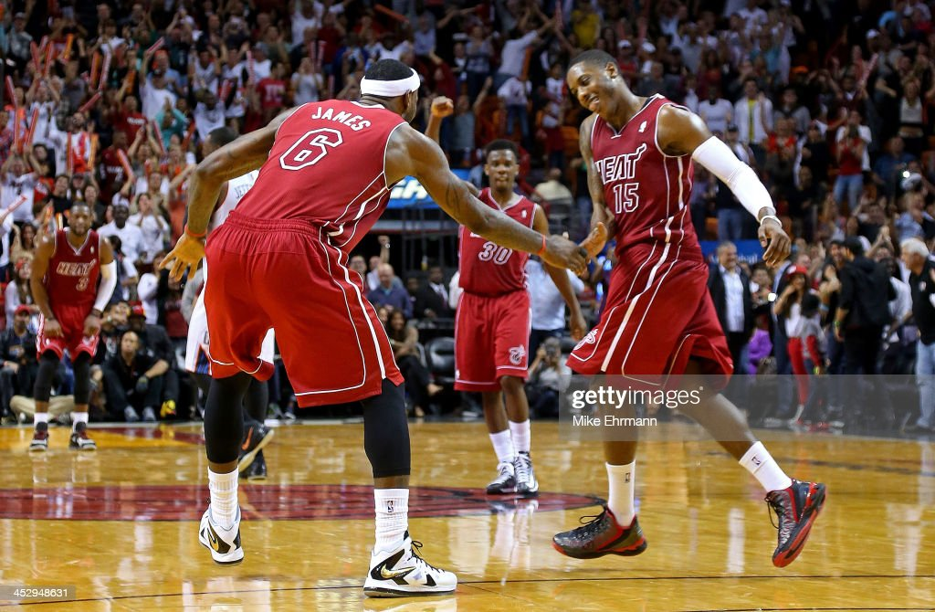 LeBron James and Mario Chalmers of the Miami Heat high five during a game against the Charlotte Bobcats at American Airlines Arena on December 1 2013...