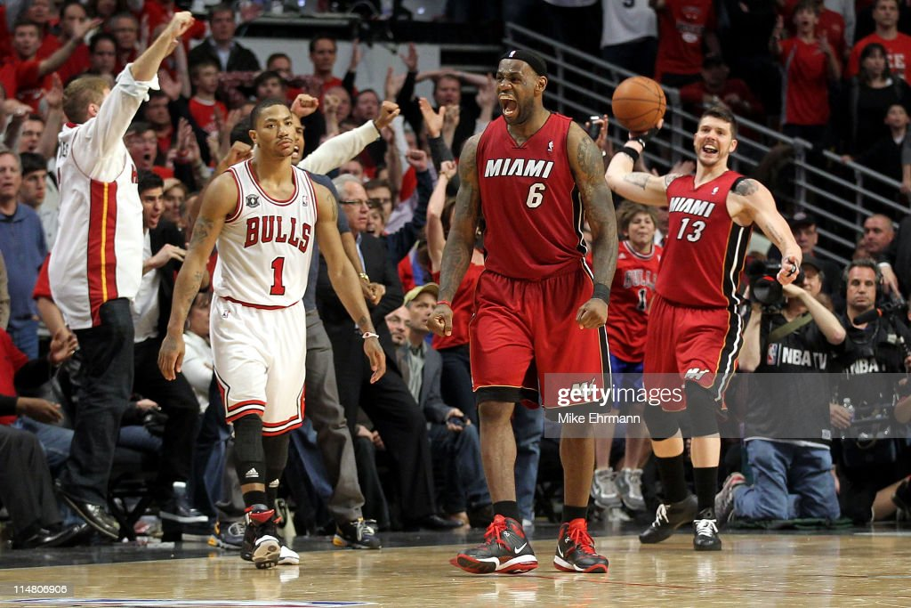 LeBron James #6 and Mike Miller #13 of the Miami Heat celebrte after they won 83-80 against Derrick Rose #1 (L) of the Chicago Bulls in Game Five of the Eastern Conference Finals during the 2011 NBA Playoffs on May 26, 2011 at the United Center in Chicago, Illinois.