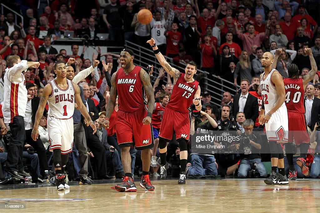 LeBron James #6 and Mike Miller #13 of the Miami Heat celebrte after they won 83-80 against Derrick Rose #1 (L) and Taj Gibson (R) #22 of the Chicago Bulls in Game Five of the Eastern Conference Finals during the 2011 NBA Playoffs on May 26, 2011 at the United Center in Chicago, Illinois.