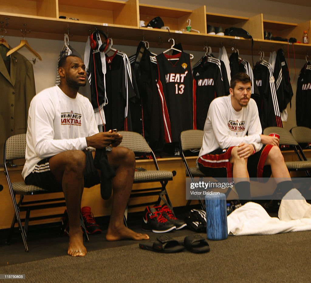 LeBron James #6 and Mike Miller #13 of the Miami Heat sit in the locker room before Game Five of the 2011 NBA Finals against the Dallas Mavericks on June 09, 2011 at the American Airlines Center in Dallas, Texas.