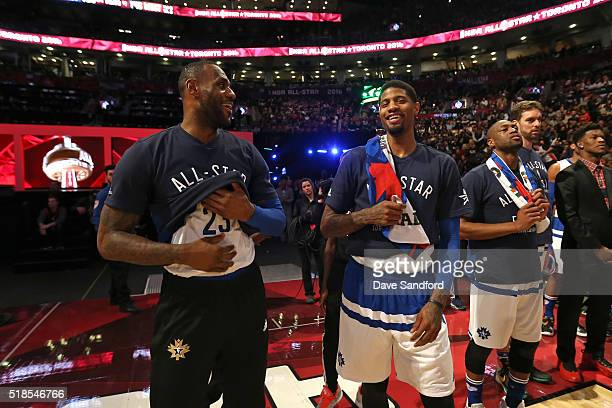 LeBron James and Paul George of the Eastern Conference stand on the court before the NBA AllStar Game as part of the 2016 NBA AllStar Weekend on...