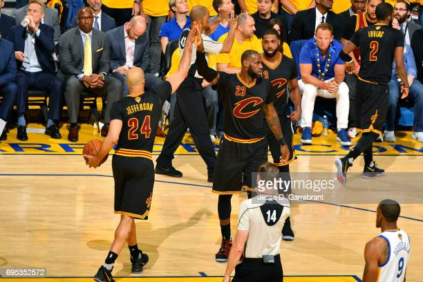 LeBron James and Richard Jefferson of the Cleveland Cavaliers high five each other during the game against the Golden State Warriors in Game Five of...