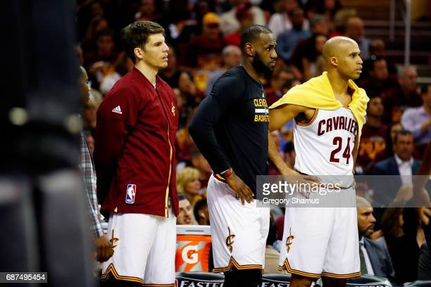 LeBron James and Richard Jefferson of the Cleveland Cavaliers look on from the bench in the first half against the Boston Celtics during Game Four of...