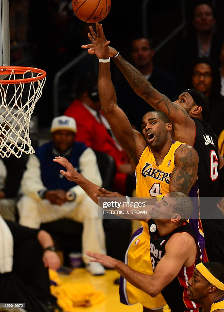 LeBron James (top) and Shane Battier of the Miami Heat vie for the ball with Antawn Johnson (2top) of Los Angeles Lakers during their NBA game on January 17, 2013 in Los Angeles, California. AFP PHOTO / Frederic J. BROWN