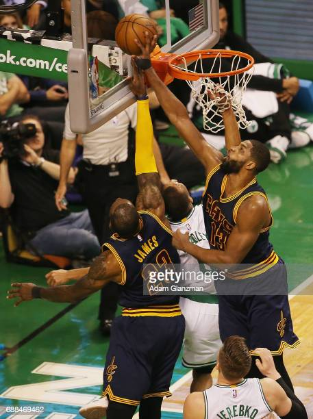 LeBron James and Tristan Thompson of the Cleveland Cavaliers block the shot of Avery Bradley of the Boston Celtics in the first half during Game Five...