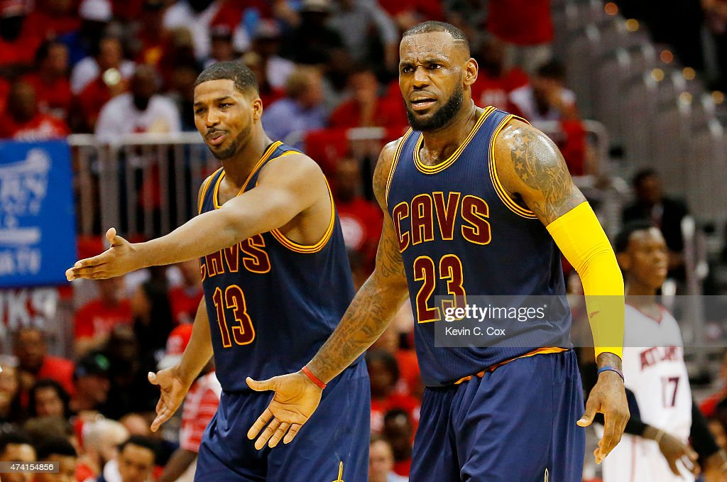LeBron James #23 and Tristan Thompson #13 of the Cleveland Cavaliers react in the second quarter against the Atlanta Hawks during Game One of the Eastern Conference Finals of the 2015 NBA Playoffs at Philips Arena on May 20, 2015 in Atlanta, Georgia.