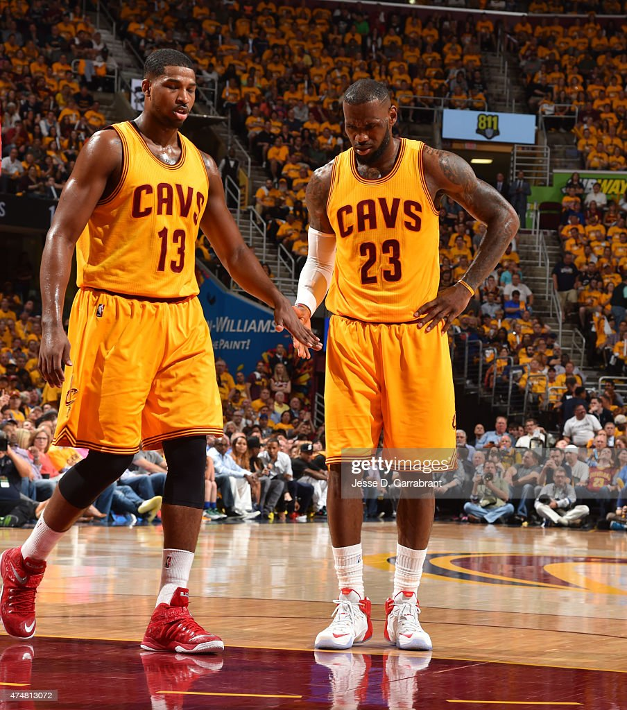 LeBron James #23 and Tristan Thompson #13 of the Cleveland Cavaliers shake hands after the play against the Atlanta Hawks at the Quicken Loans Arena During Game Four of the Eastern Conference Finals during the 2015 NBA Playoffs on May 26, 2015 in Cleveland,Ohio